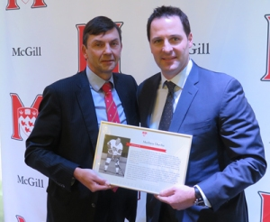 Mathieu Darche getting his award, from Mike Nelson from Friends of McGill Hockey